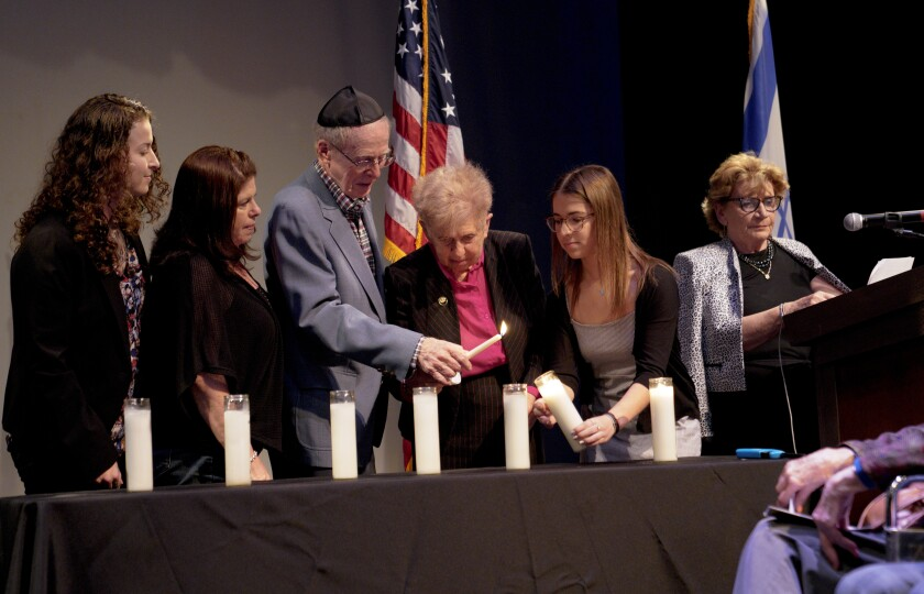 At the Community Holocaust Commemoration held in La Jolla on Sunday, Mike (3rd from left) and Manya Wallenfels both Holocaust survivors were among those invited to the stage for the candle lighting ceremony.