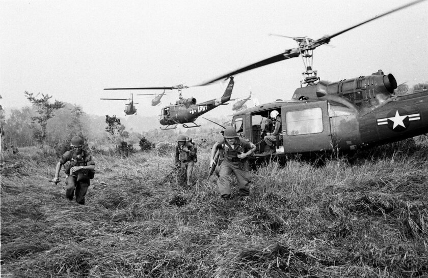 American soldiers are dropped off by U.S.Army helicopters to join South Vietnamese ground troops to advance in an attack on a Viet Cong camp 18 miles north of Tay Ninh, northwest of Saigon near the Cambodian border, in March 1965 during the Vietnam War.  (AP Photo/Horst Faas)