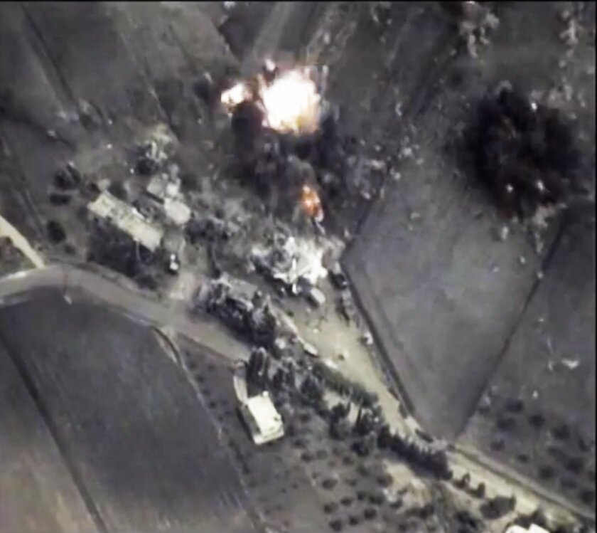 In this photo made from footage taken from the Russian Defense Ministry website on Oct. 1, 2015, a bomb explodes in Syria.