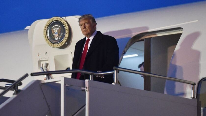 """President Trump disembarks from Air Force One in Moon Township, Pa., on Saturday for a rally. Trump spoke to the audience about North Korea: """"Who knows what's going to happen?"""""""