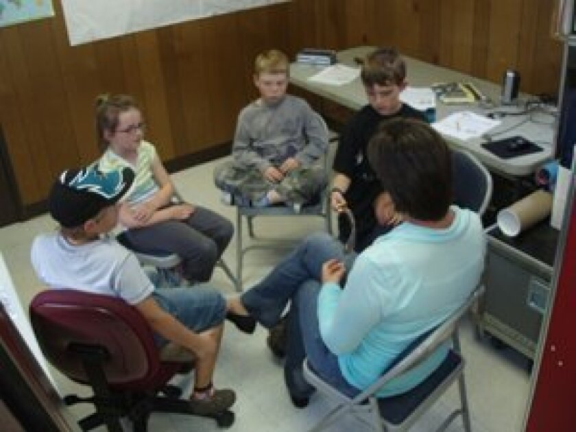 Teacher Julie Grenier with young students.