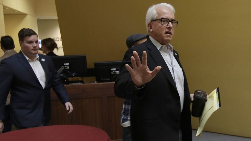 Republican candidate John Cox gestures toward reporters after a California gubernatorial debate with Democratic candidate Gavin Newsom at KQED Public Radio Studio in San Francisco on Oct. 8.