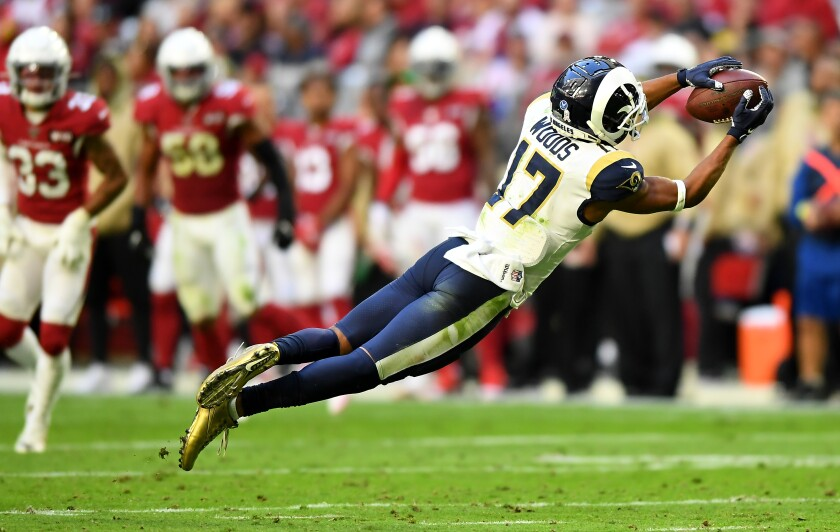 Rams receiver Robert Woods makes one of his 13 receptions against the Arizona Cardinals.
