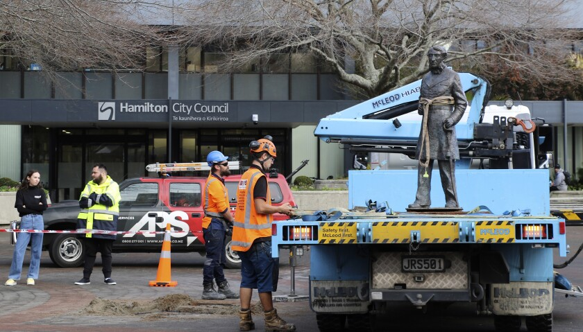 A bronze statue of British Capt. John Hamilton is removed in New Zealand.