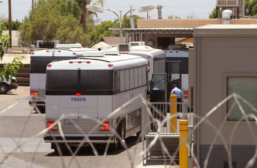 View of buses at the U.S. Immigration and Customs Enforcement El Centro Service Processing Center at 1115 N. Imperial Avenue in El Centro.