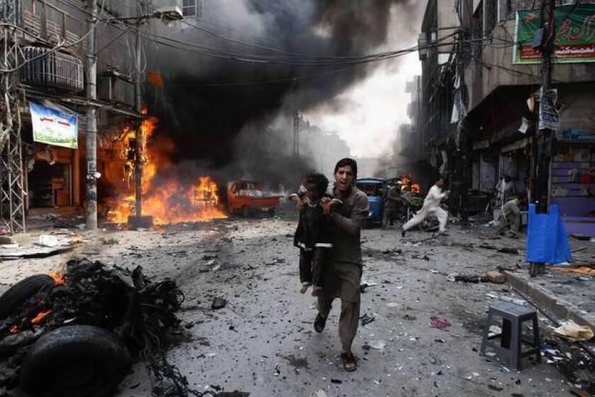 Car bomb kills dozens at bazaar in Peshawar, Pakistan