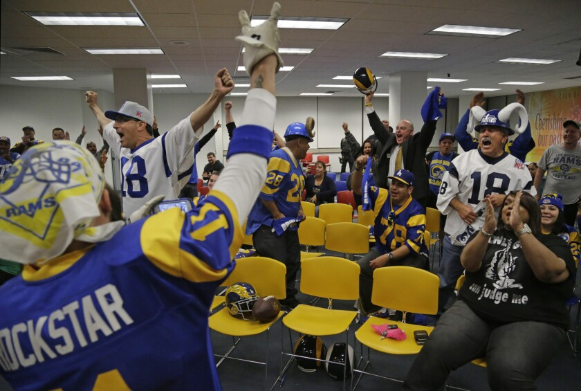 Supporters celebrate after the Inglewood City Council voted in 2015 to approve an 80,000-seat football stadium at the site of the old Hollywood Park racetrack.