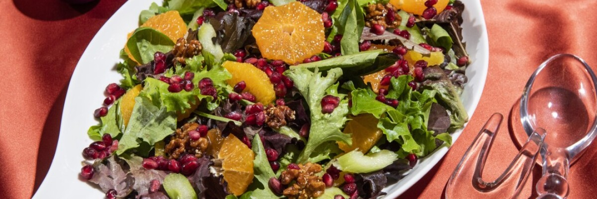 Citrus and pomegranate seeds add bright colors and flavors to a mixed green salad.