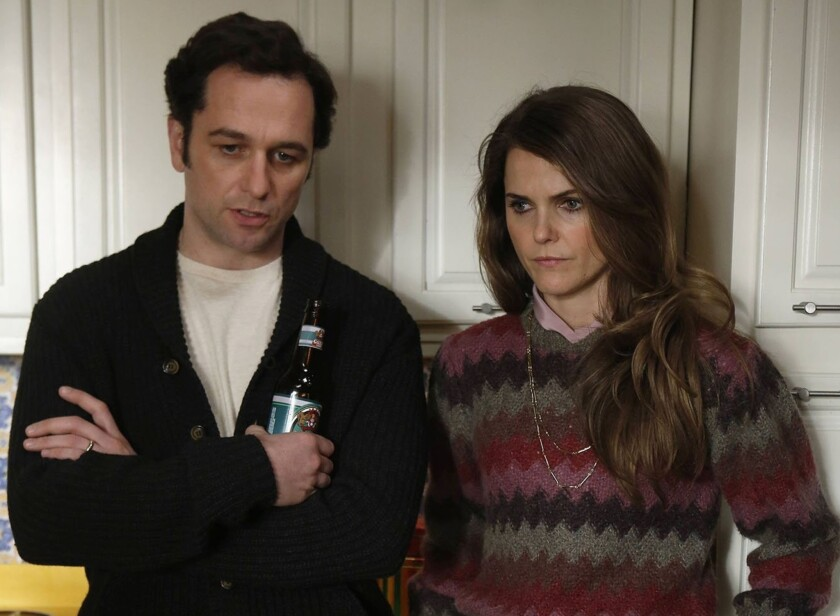 """""""The Americans"""" costars Matthew Rhys and Keri Russell are fueling dating rumors. The actors are pictured here in character for the FX drama."""