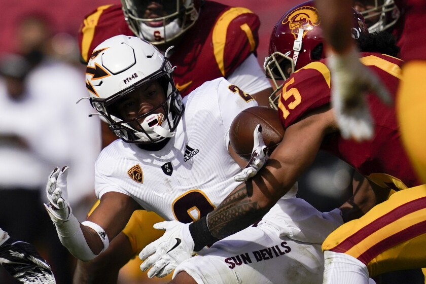 The ball comes loose for a fumble as Arizona State wide receiver LV Bunkley-Shelton is tackled by USC safety Talanoa Hufanga.