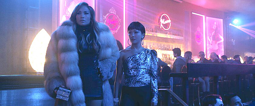 "Jennifer Lopez and Constance Wu in the movie ""Hustlers."""