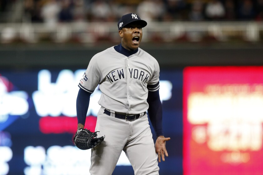New York Yankees relief pitcher Aroldis Chapman celebrates after his team's 5-1 victory over the Minnesota Twins in Game 3 of a baseball American League Division Series, Monday, Oct. 7, 2019, in Minneapolis. (AP Photo/Jim Mone)