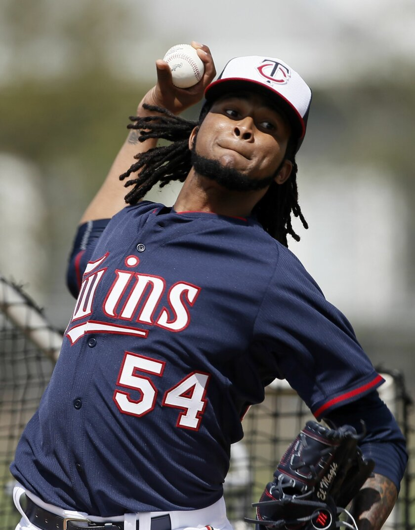 FILE - In this Tuesday March 3, 2015 file photo, Minnesota Twins starting pitcher Ervin Santana (54) throws batting practice at baseball spring training in Fort Myers, Fla. Minnesota Twins pitcher Ervin Santana has been suspended for 80 games by Major League Baseball after testing positive for the performance-enhancing substance Stanozolol. MLB announced the punishment Friday, April 3, 2015. (AP Photo/Tony Gutierrez, File)