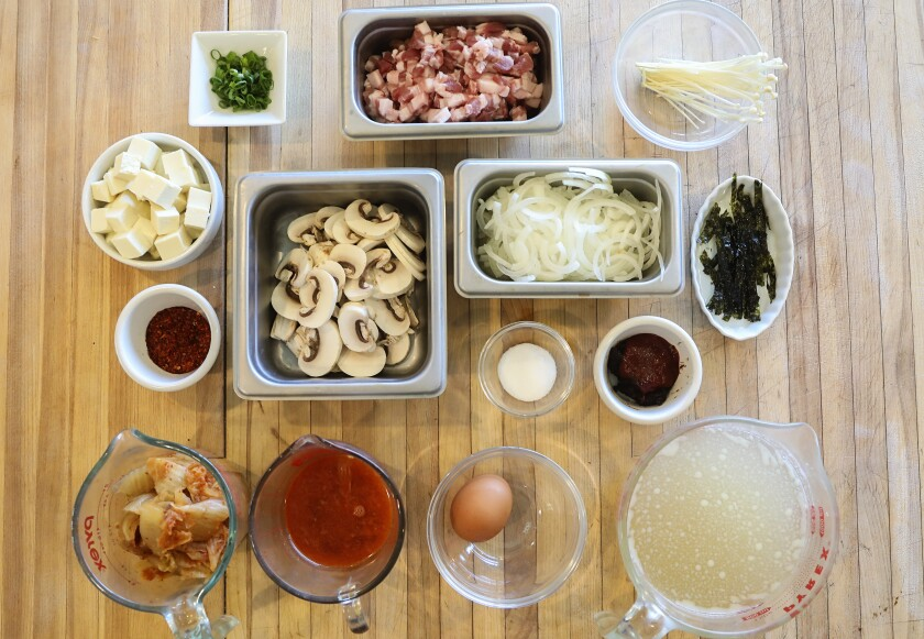 "The many ingredients of Kimchi Jjigae add layers of umami, or ""deliciousness."" At bottom left are the kimchi and its juices."