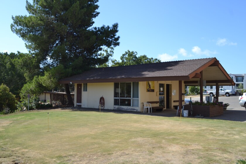 The putting green and pro shop at Town Park Villas Golf Course.
