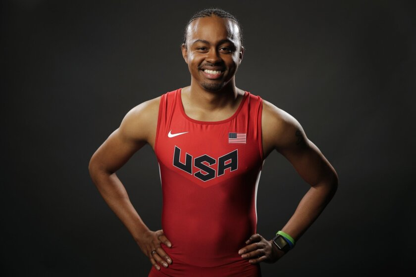 FILE - In this March 7, 2016, file photo, track and field athlete Aries Merritt poses for photos at the 2016 Team USA Media Summit in Beverly Hills, Calif. Defending Olympic champion Aries Merritt says he'll go to Brazil if he makes the U.S. team, even though Zika poses a greater risk to him becaus