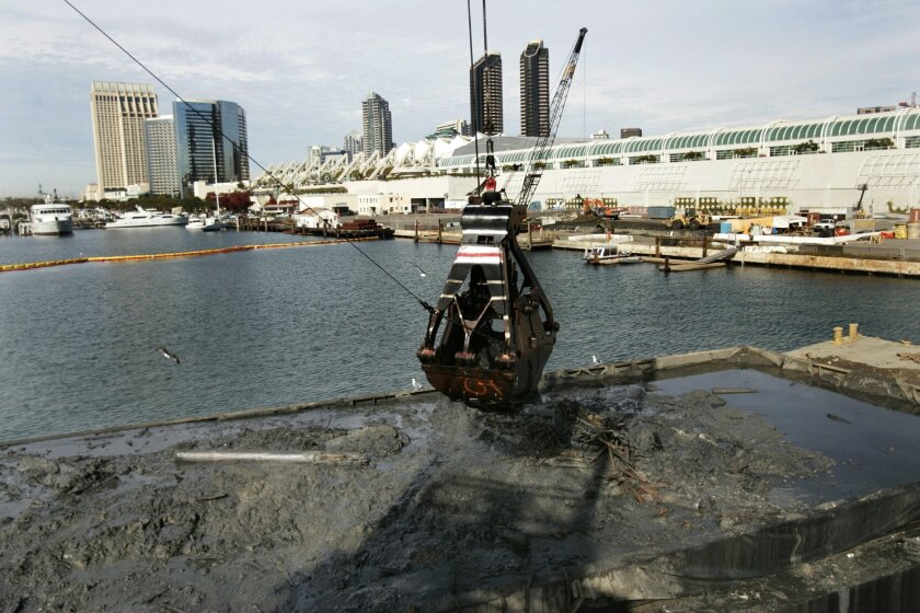 Crews removed sludge from the site of the former Campbell Industries shipyard south of the San Diego Convention Center in 2005. (U-T file)