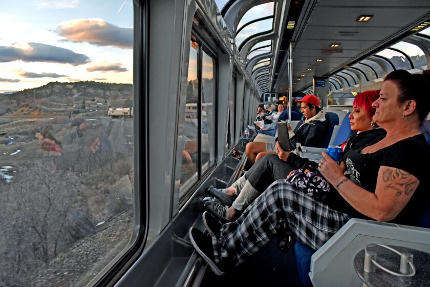 The Sightseer Lounge as the train drops down from Raton Pass, N.M., at dusk on the Southwest Chief.