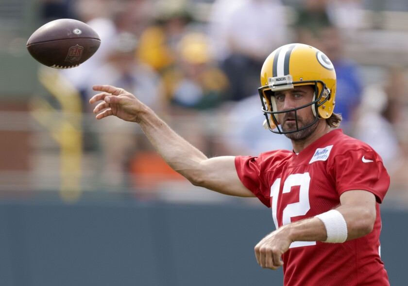 Green Bay Packers' quarterback Aaron Rodgers passes during NFL football training camp Wednesday, July 28, 2021, in Green Bay, Wis. (AP Photo/Matt Ludtke)
