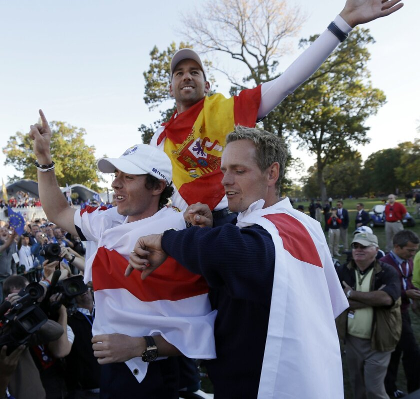 Europe's Rory McIlroy, Sergio Garcia and Luke Donald celebrate after winning the Ryder Cup PGA golf tournament Sunday, Sept. 30, 2012, at the Medinah Country Club in Medinah, Ill.