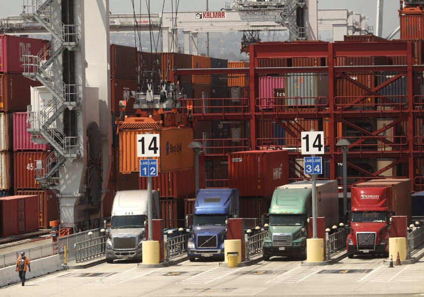 Trucks line up to drop off their loads at the Port of Los Angeles on August 27, 2020.