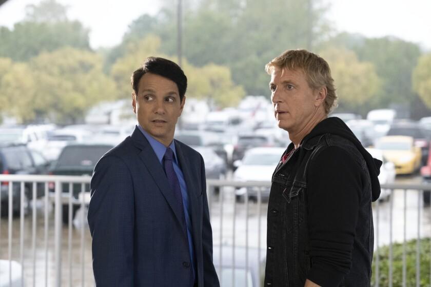 "Ralph Macchio, left, as Daniel LaRusso opposite William Zabka as Johnny Lawrence in the Netflix series ""Cobra Kai."""