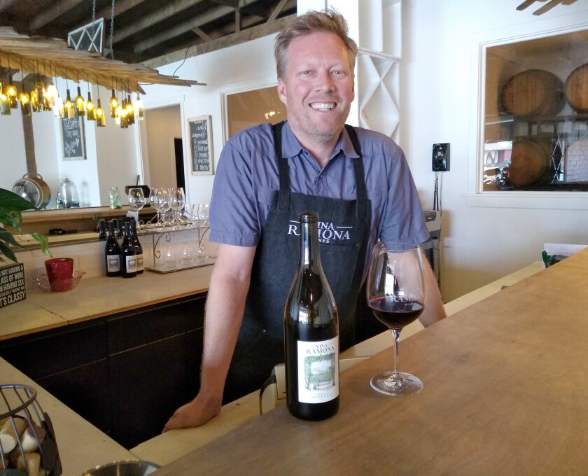 Benjamin Payne pours a glass of wine at the bar of Vina Ramona winery he opened recently with partner Micah Van Bogelen. The winery is at 636 Main St.