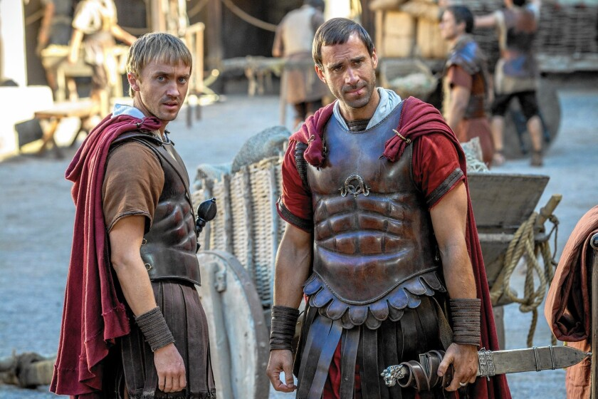 """Joseph Fiennes, right, portrays a Roman tribune and Tom Felton is his aide in the biblical epic """"Risen."""""""
