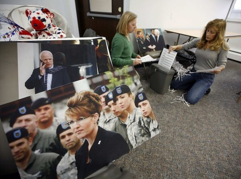 Workers pack up the McCain-Palin campaign headquarters in Anchorage. Aides to McCain on Wednesday disclosed new details about Palin's expensive wardrobe purchases and other conflicts.