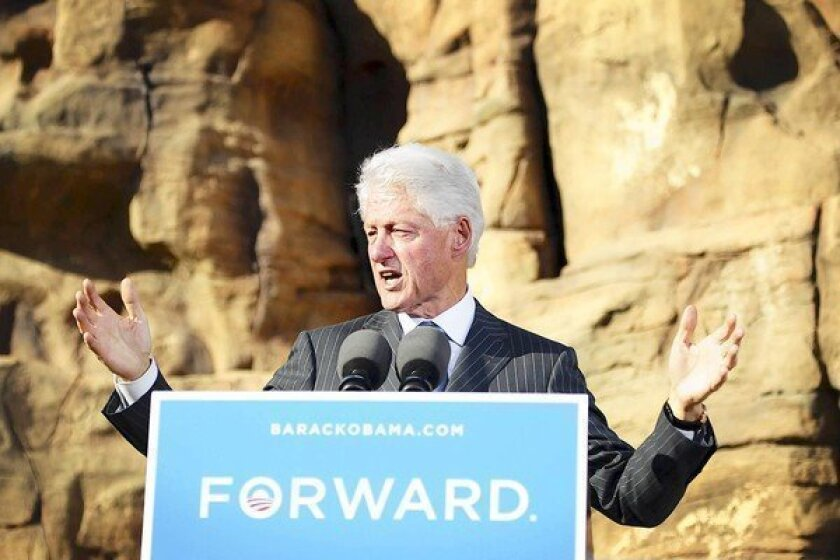 Former President Clinton campaigns for President Obama at the Springs Preserve in Las Vegas. He mocked Mitt Romney's debate performance and some Republicans' negative reaction to Friday's positive jobs report.