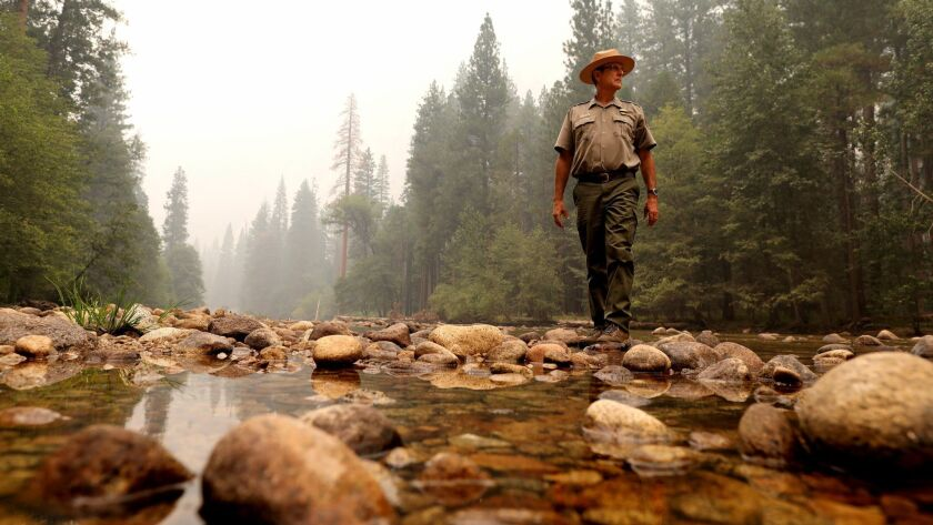 Scott Gediman, a Yosemite National Park spokesman, on the Merced River next to the temporarily closed Lower Pines camp in Yosemite Valley.