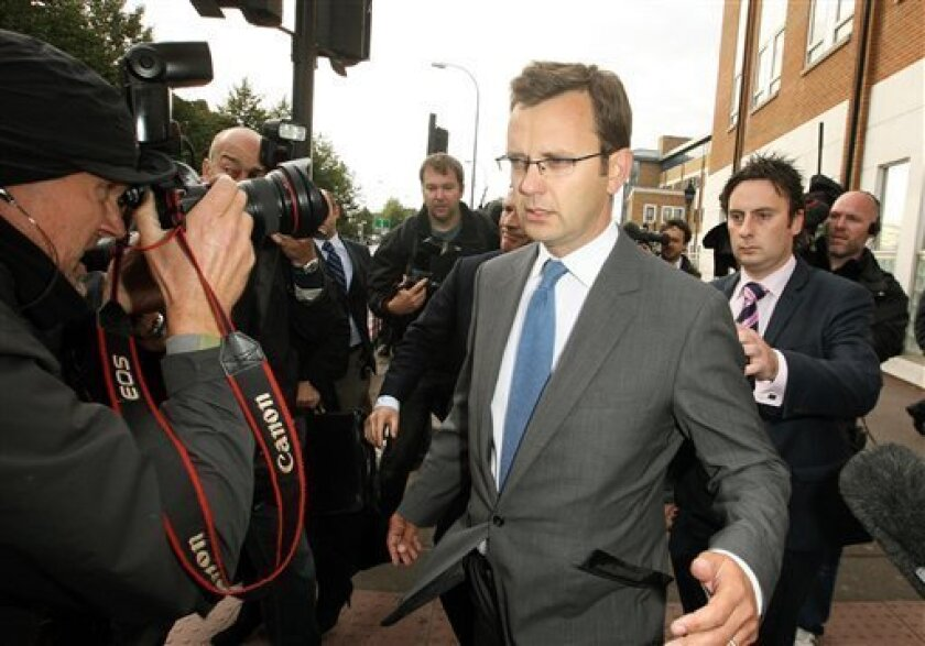 Former Downing Street communication chief Andy Coulson surrounded by media as he leaves Lewisham police station in south London, after being arrested in a phone hacking and police corruption scandal, Friday July 8, 2011. Coulson, British Prime Minister David Cameron's former communications chief and Clive Goodman,an ex-royal reporter for the News of the World tabloid were arrested Friday, the latest to be swept up in a scandal over phone hacking and bribing police that has already toppled a newspaper and rattled the relationship between top politicians and the powerful Murdoch media empire. (AP Photo/PA, Dominic Lipinski) UNITED KINGDOM OUT NO SALES NO ARCHIVE
