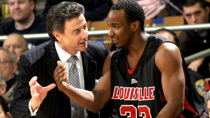 Louisville Coach Rick Pitino talks to guard Andre McGee during a game against Notre Dame last season.