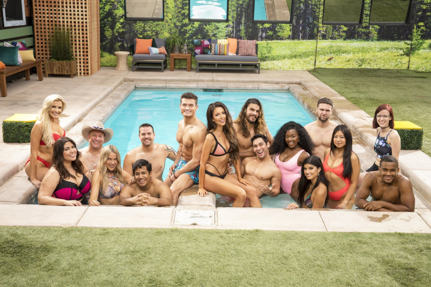 "The 16 house guests of ""Big Brother,"" Season 21."