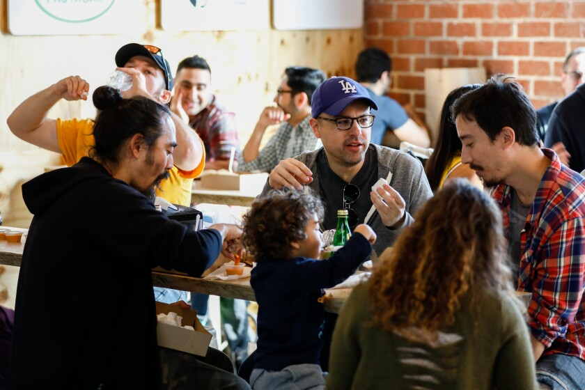 Yumi Chapman, left, son Malakai Chapman, 2, Pablo Rico, Dean Chapman and Cambria Hunt dine on food from different restaurants at Colony.