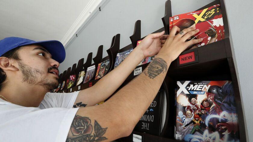 LOS ANGELES, CA-JULY 11, 2018: Gordon Medina, 24, of Los Angeles looks at the Marvel comic book, X-