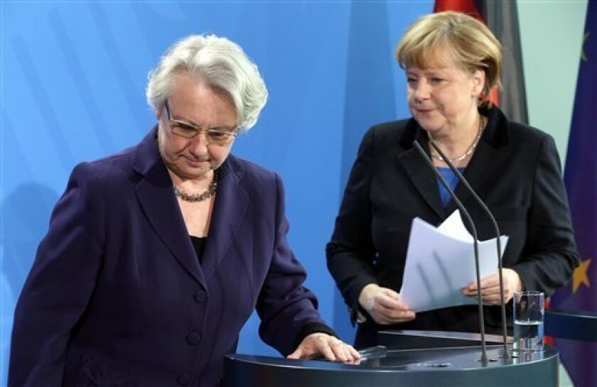 German chancellor Angela Merkel , right, and education minister Annette Schavan, left, arrive for a statement in Berlin Saturday, Feb. 9, 2013. Germany's education minister has resigned after a university decided to withdraw her doctorate, finding that she plagiarized parts of her thesis - an embarrassment for Chancellor Angela Merkel's government months before national elections. (AP Photo/dpa, Wolfgang Kumm)