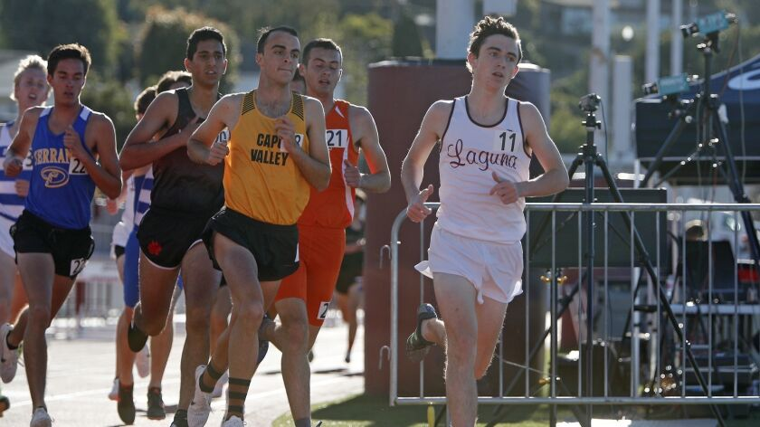 Laguna Beach High's Ryan Smithers (11) runs in the Eric Hulst boys' 3,200-meter race during the Lagu