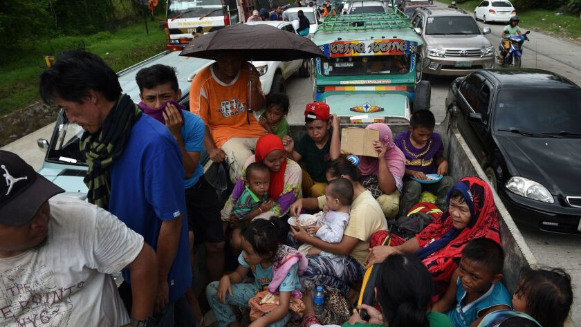 Residents fleeing Marawi city on May 24, 2017.
