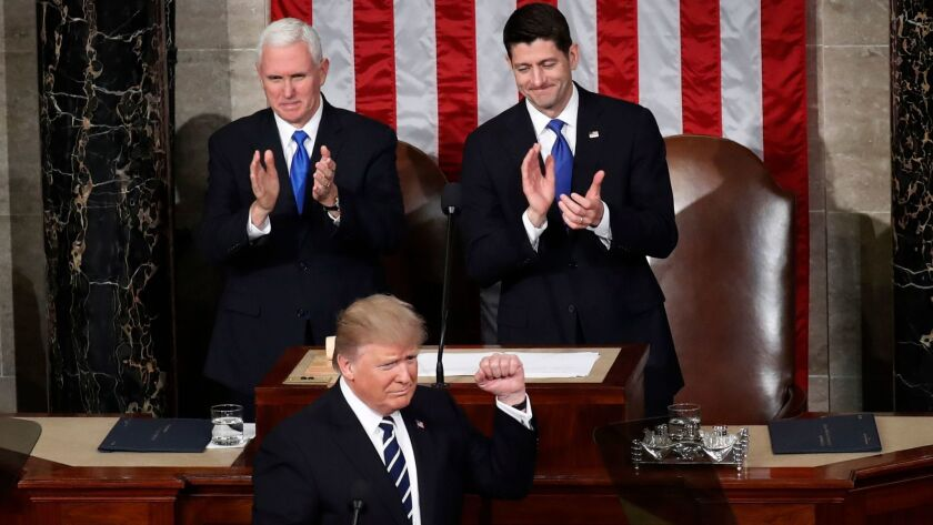 President Donald Trump, backed by Vice President Mike Pence, left, and House Speaker Paul Ryan of Wisconsin, addresses Congress in Washington on Feb. 28.