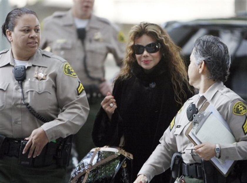 LaToya Jackson arrives for the preliminary hearing for Michael Jackson's doctor Conrad Murray, charged in the death of the singer, at Los Angeles Superior Court Thursday, Jan 6, 2011. (AP Photo/Nick Ut)