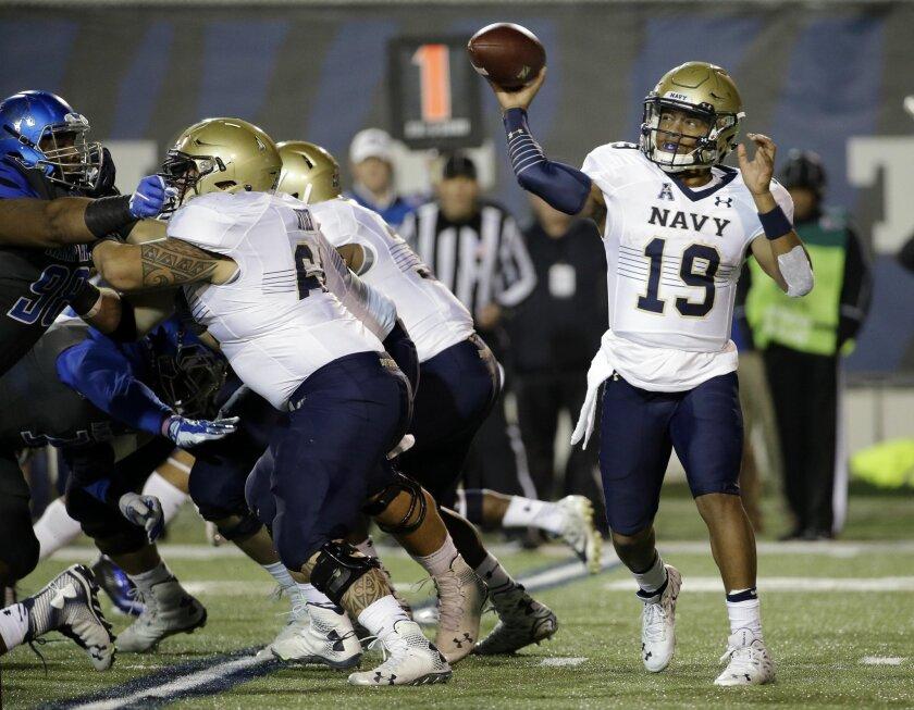 Navy quarterback Keenan Reynolds (19) passes against Memphis in the first half of an NCAA college football game Saturday, Nov. 7, 2015, in Memphis, Tenn. (AP Photo/Mark Humphrey)