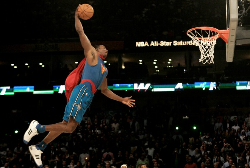 Dwight Howard soars toward the basket during the slam dunk contest at the New Orleans Arena during All-Star weekend in 2008.