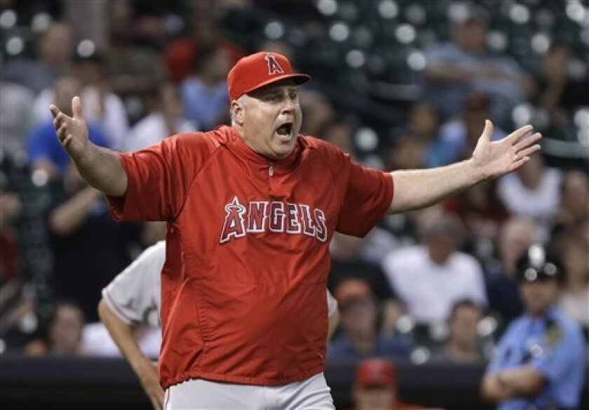Los Angeles Angels manager Mike Scioscia questions the umpires on a Houston Astros pitching change in the seventh inning of a baseball game Thursday, May 9, 2013, in Houston. (AP Photo/Pat Sullivan)