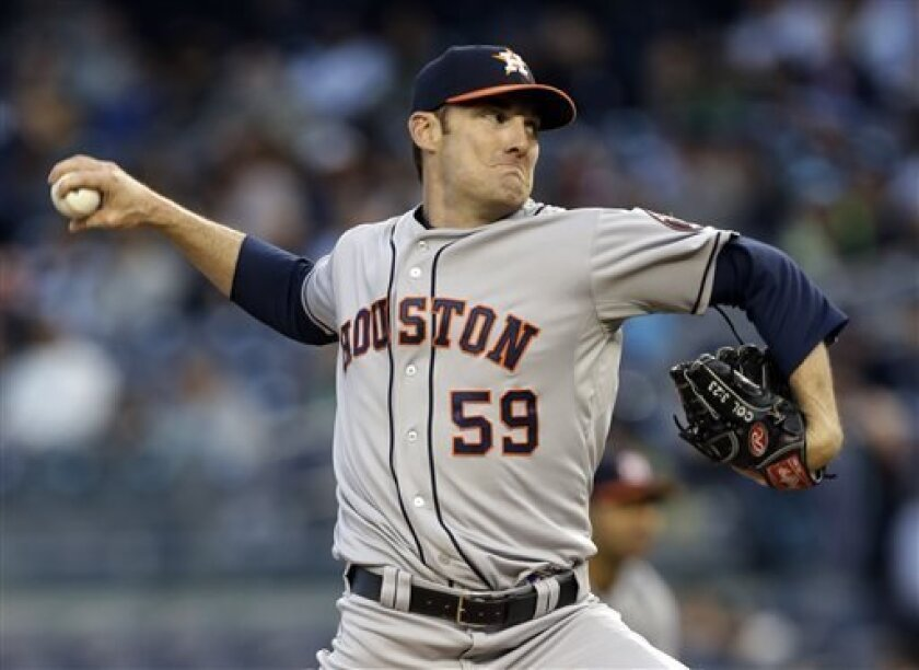 Houston Astros starting pitcher Philip Humber delivers against the New York Yankees in the first inning of a baseball game at Yankee Stadium in New York, Tuesday, April 30, 2013. (AP Photo/Kathy Willens)