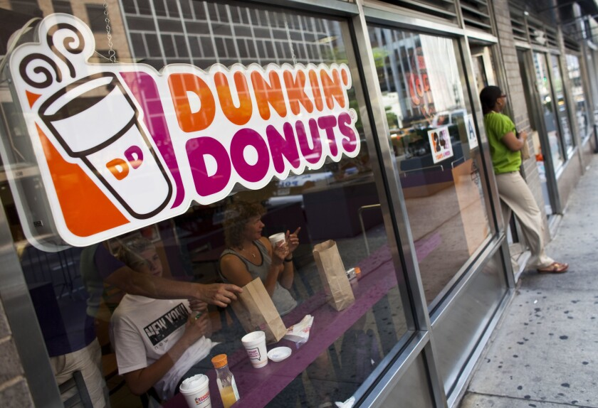 A customer exits a Dunkin' Donuts store in midtown where DD Perk members are being asked to change their passwords.