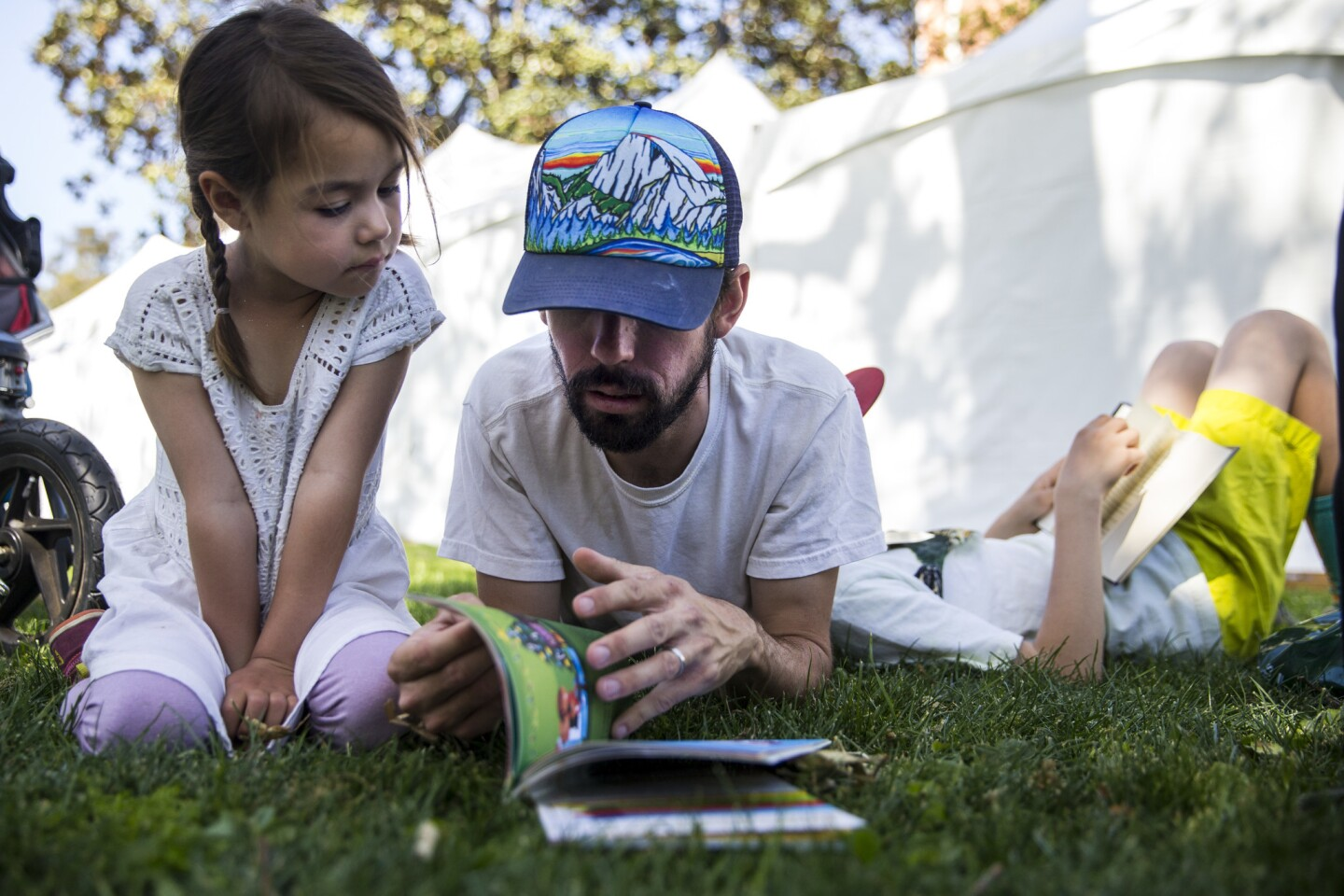 Aurora Carrillo-Vincent, 5, and Matthew Carrillo-Vincent, 35, read together during the Los Angeles Times Festival of Books at USC on Sunday.