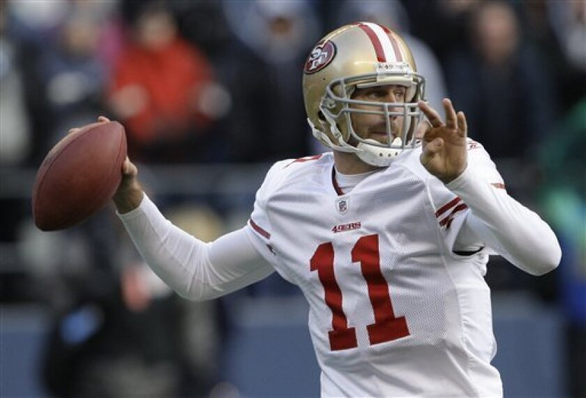 San Francisco 49ers quarterback Alex Smith get set to pass in the first quarter against the Seattle Seahawks during an NFL football game, Sunday, Dec. 6, 2009, in Seattle. (AP Photo/Elaine Thompson)