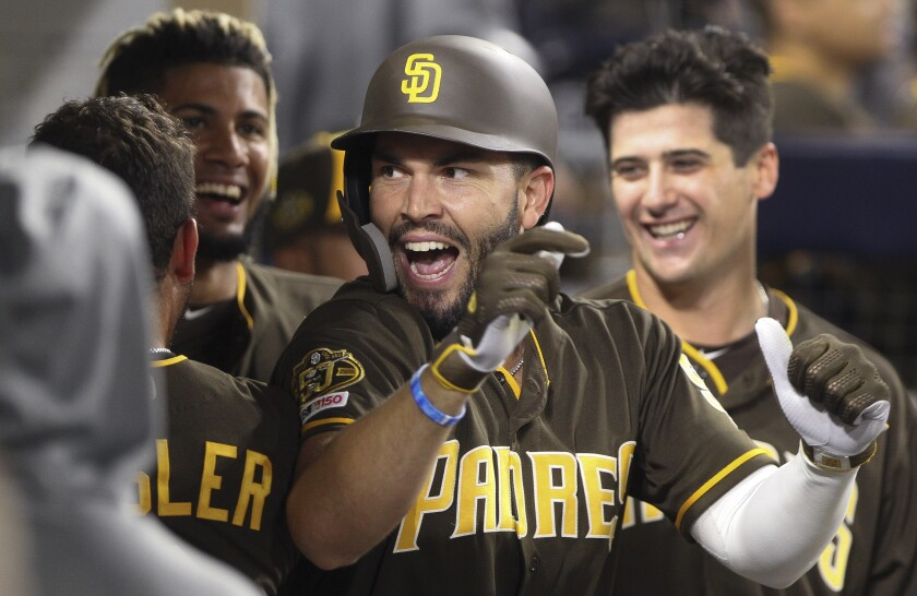 The Padres' Eric Hosmer is congratulated in the dugout after he hit a home run in the sixth inning against the Cardinals at Petco Park on Friday, June 28.