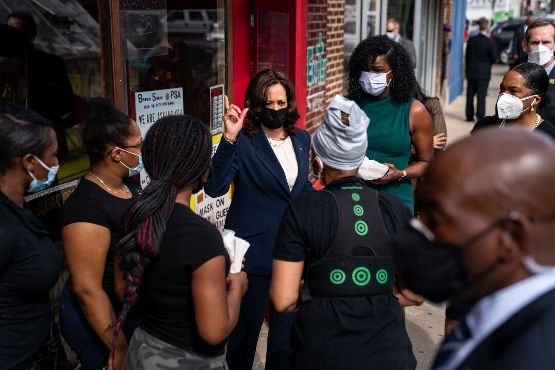 Vice President Kamala Harris speaks to a small group of people